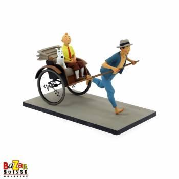 Figurine Tintin et Milou dans le pousse-pousse