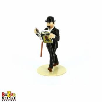 Thomson reading Tintin figurine